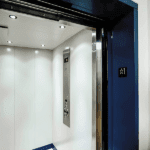Interior look of LU/LA elevator, showing car operating panel and ceiling lights