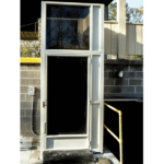 Vertical platform lift with smoked acrylic inset