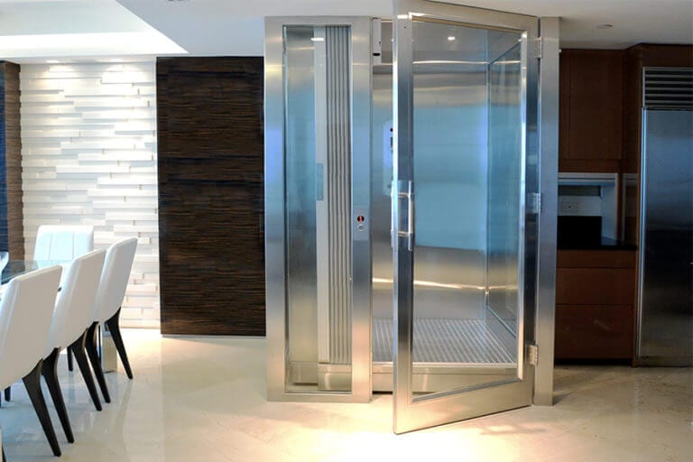 Glass and stainless steel home elevator