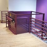Symmetry Custom Vertical Platform Lift purple commercial setting installed by Area Access
