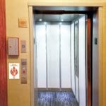 Symmetry LULA Elevator Gray Cab with White Laminate Panels installed by Arrow Lift