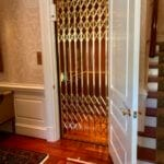 Brass Gate Closed on Symmetry Home Elevator
