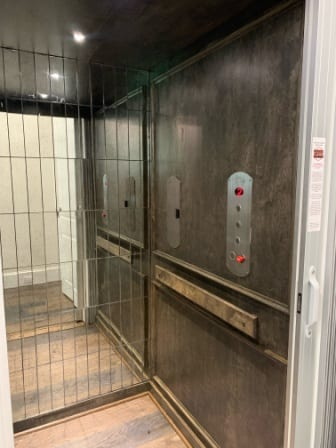 Symmetry Home Elevator Flat Panel with custom finishes in the field